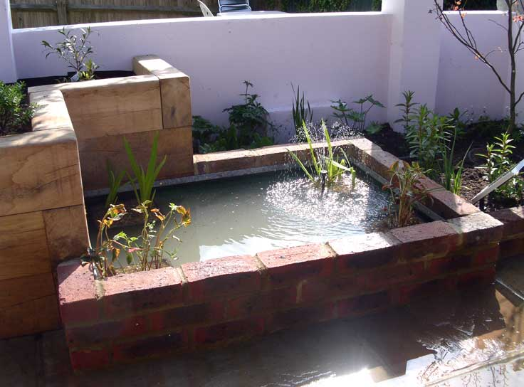 Hanover ponds brighon and hove previous pond design work for Raised garden pond ideas uk